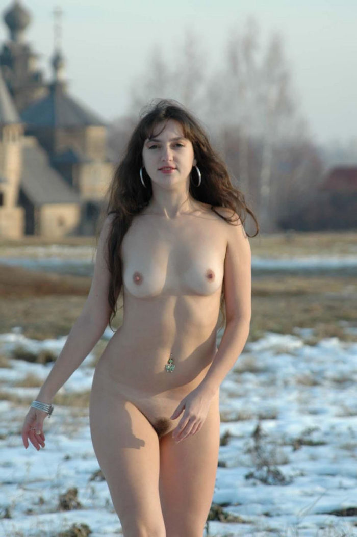 Girl Angelika loves to walk naked at winter