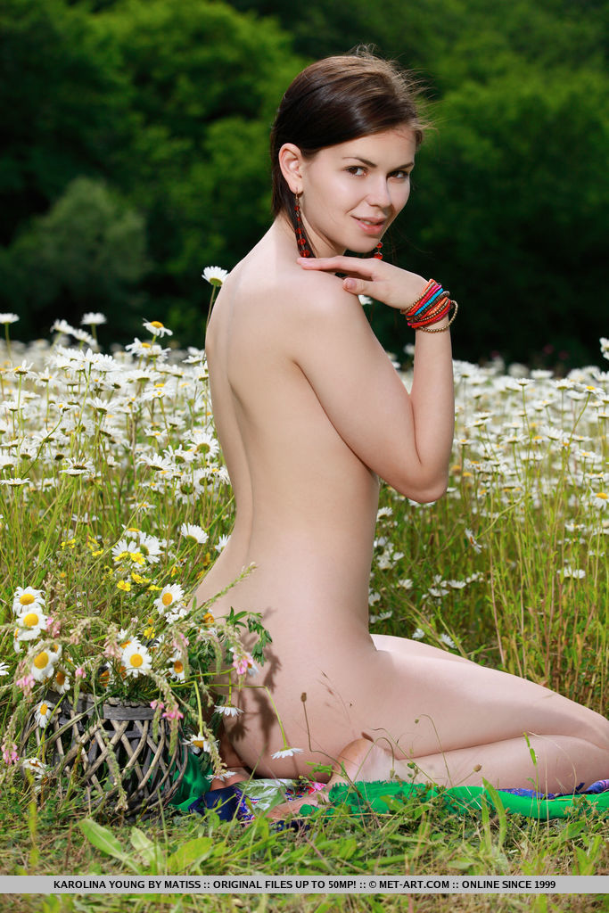 Karolina Young delightfully poses among the flowery field as she bares her amazing body   with delectable tits.