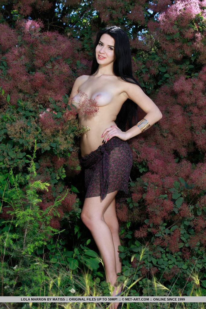 Lola Marron displays her creamy white body and sweet, pink   pussy as she poses outdoors.