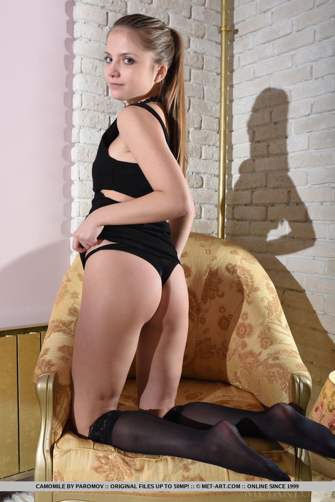 Newcomer Camomile spreads her legs wide open as she bares her sweet, smooth pussy on the chair.