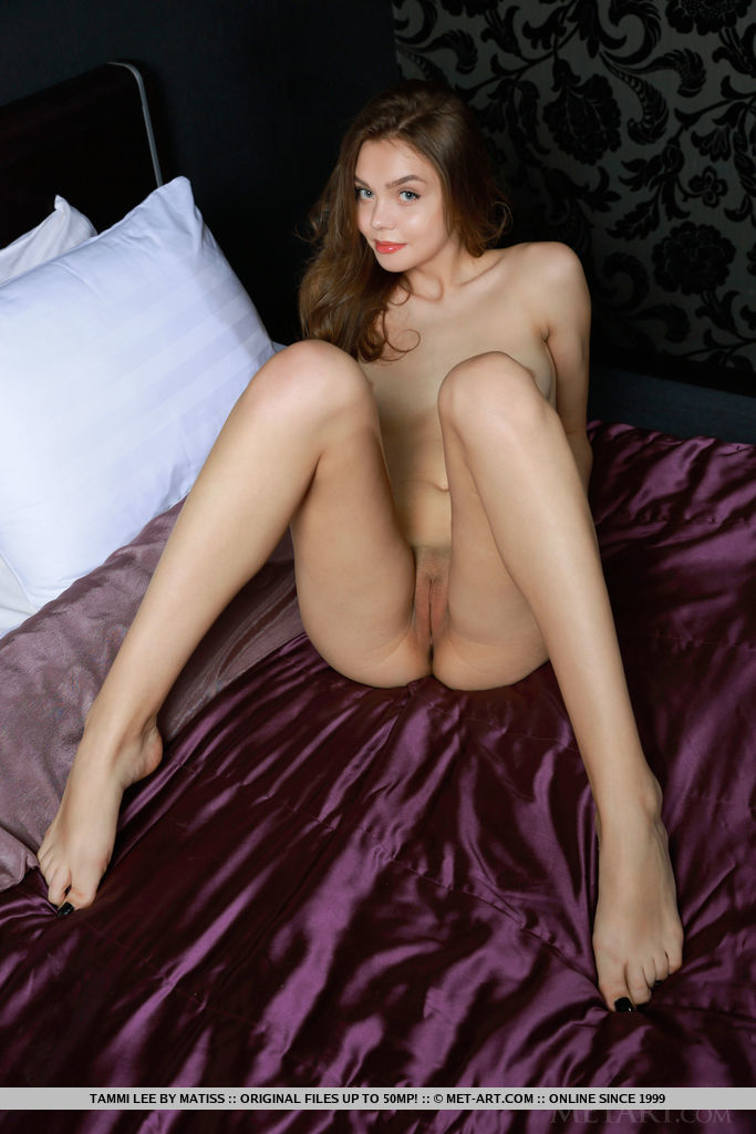 Newcomer Tammi Lee flaunts her slender body with tight butt   as she poses on the bed.