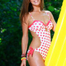 Gorgeous Fernanda on yellow beach mattress