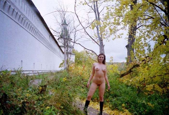 Old photos of naked blonde near old monastery