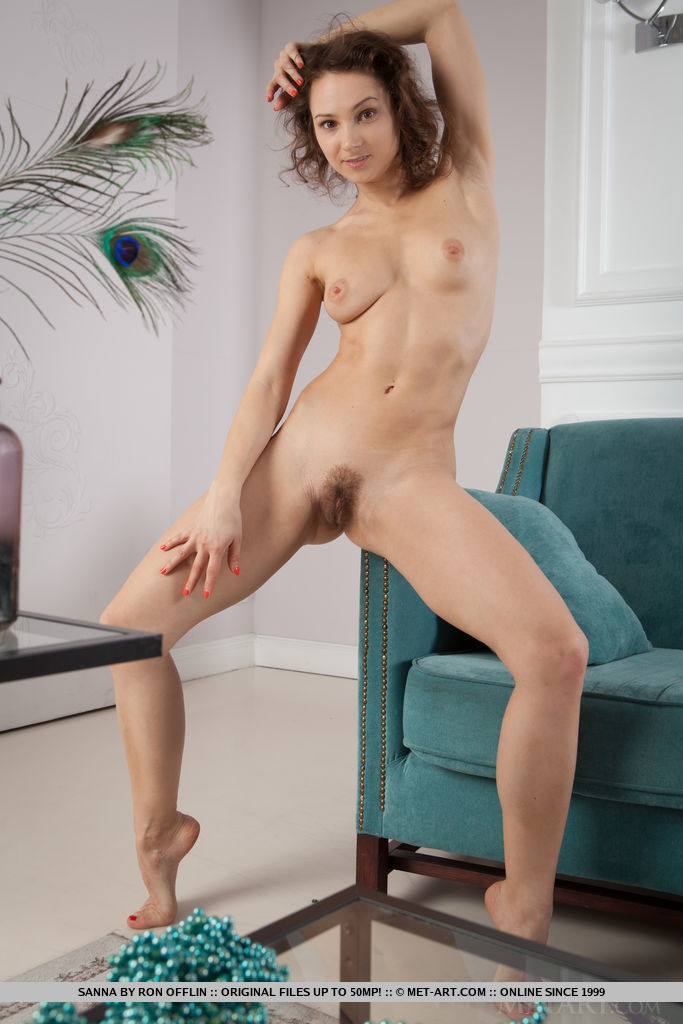 Sanna sensually poses on the couch baring her tight body and unshaven pussy.
