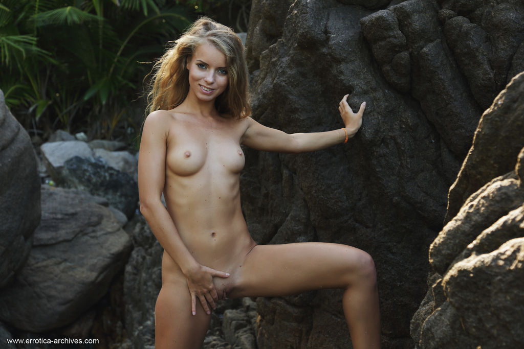 Stella Lane strips her yellow bikini baring her smoking hot body as she poses by the rocky beach.