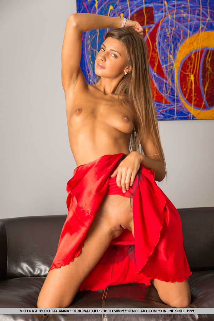 Top model Melena A bares her lusty, slender body with sweet pussy as she strips her red dress.