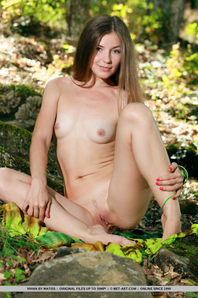 Vivian dispalys her nubile body and sweet pussy as she poses in the forest.