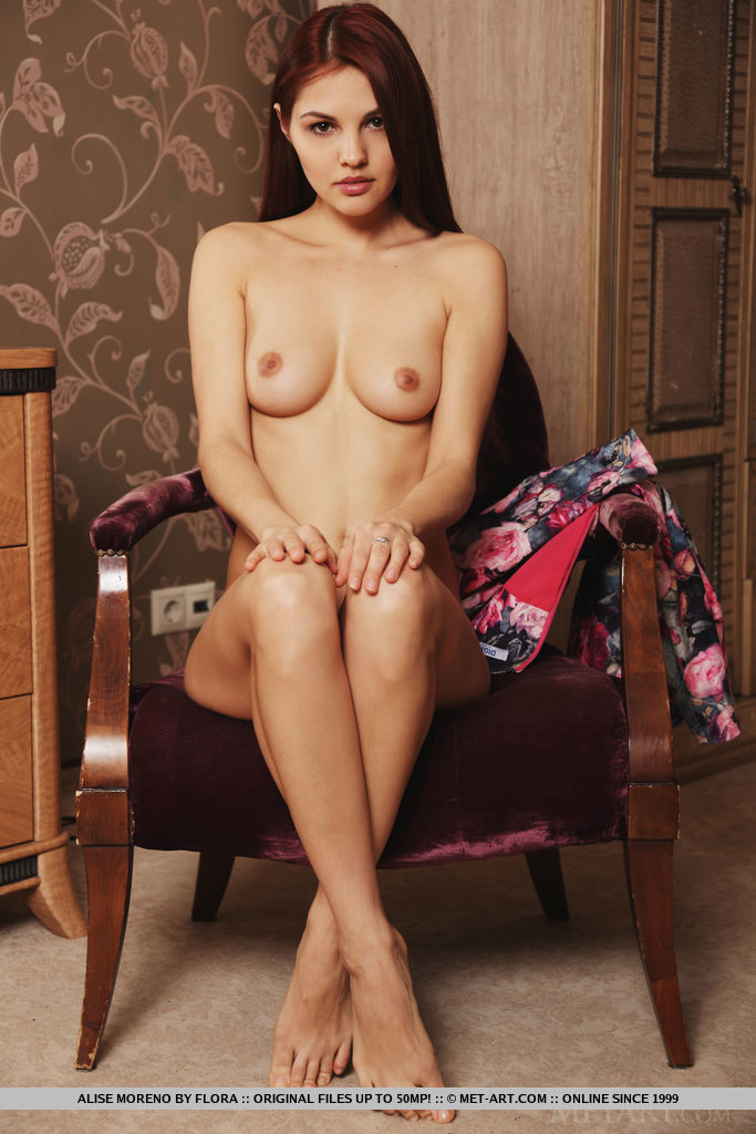 Alise Moreno bares her delectable pussy and slender body on the chair.
