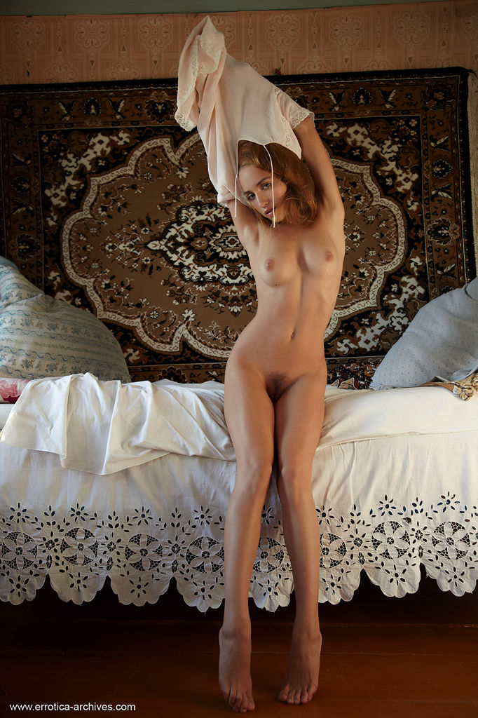 Alluring Zara sensually poses on the bed as she flaunts her gorgeous body and hairy pussy.