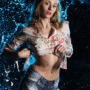 Blonde Rebecca G in denim shorts at wet studio