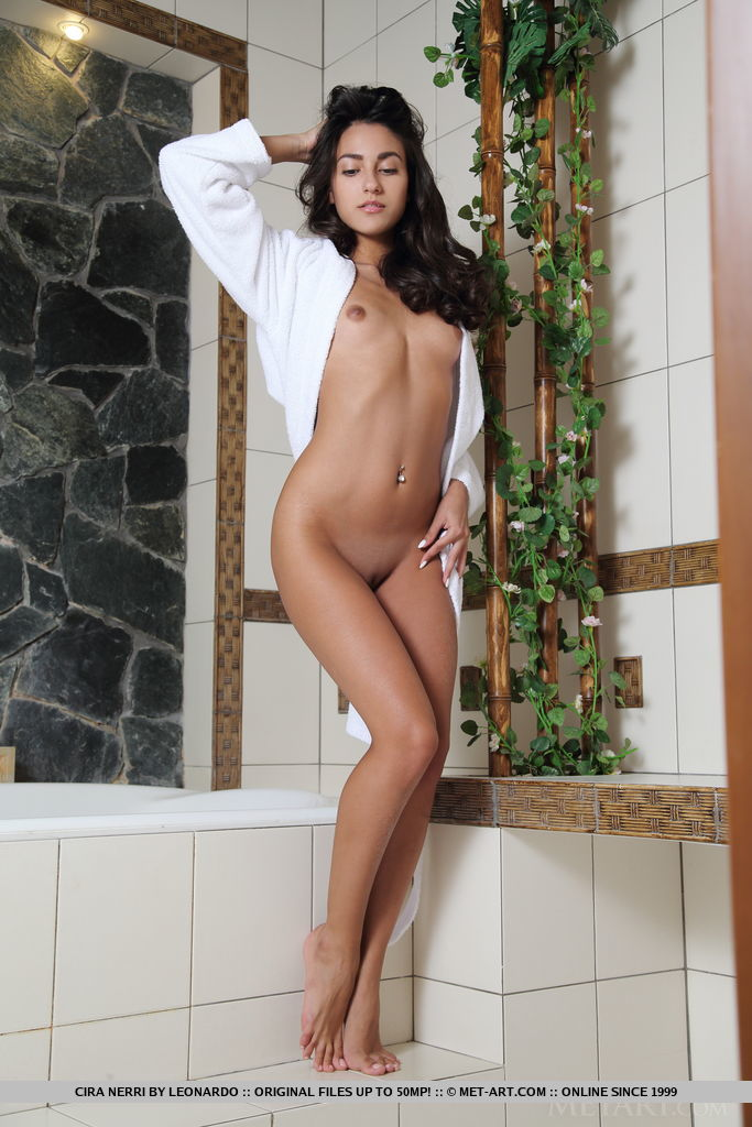 Cira Nerri flaunts her sexy, tanned body with small tits and sweet pussy as she poses in the bathroom.