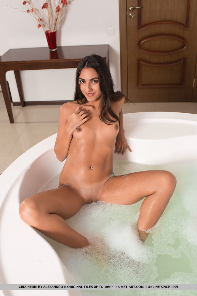 Cira Nerri shows off her choco, brown skin sweet pussy as she poses in the bathtub.