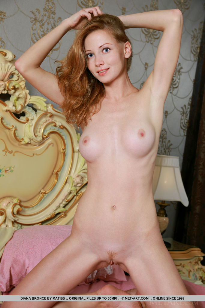 Diana Bronce strip on the bed baring her beautiful tits and pink pussy.