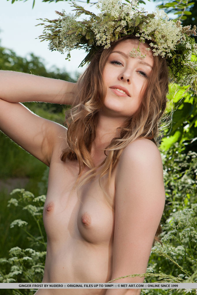 Ginger Frost delightfully poses on the grassy field baring he unshaven pussy.