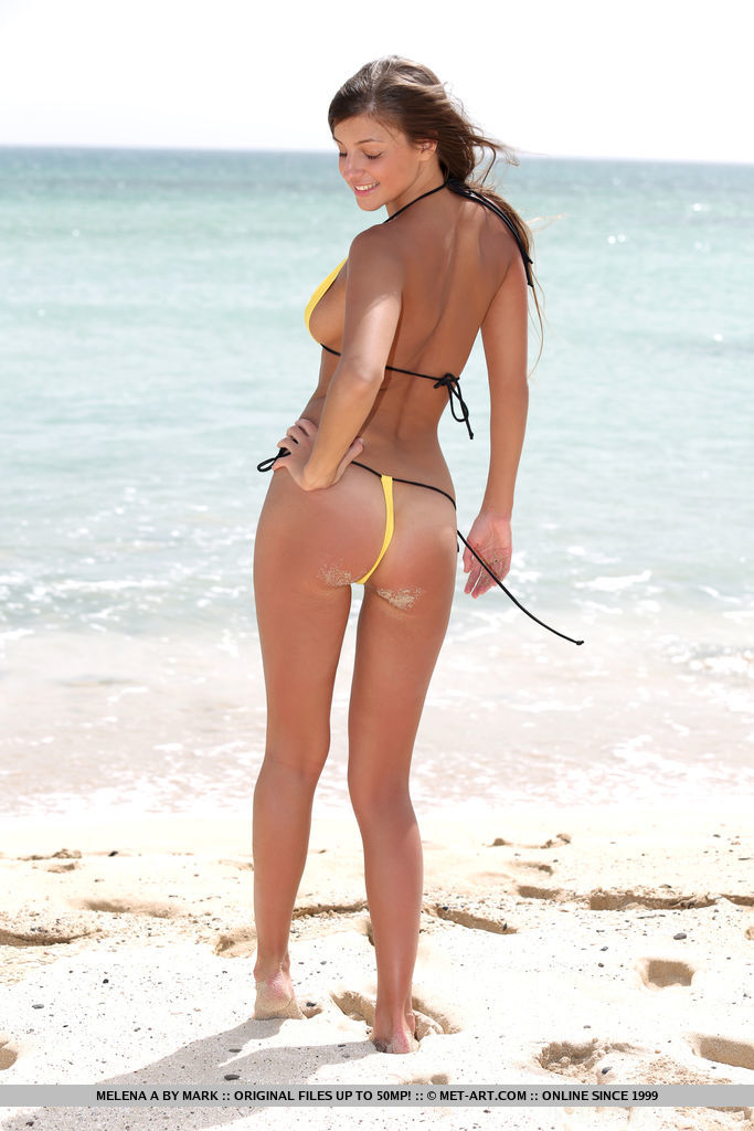 Melena A strips her sexy bikini as she flaunts her sexy, tanned body and sweet pussy by the beach.