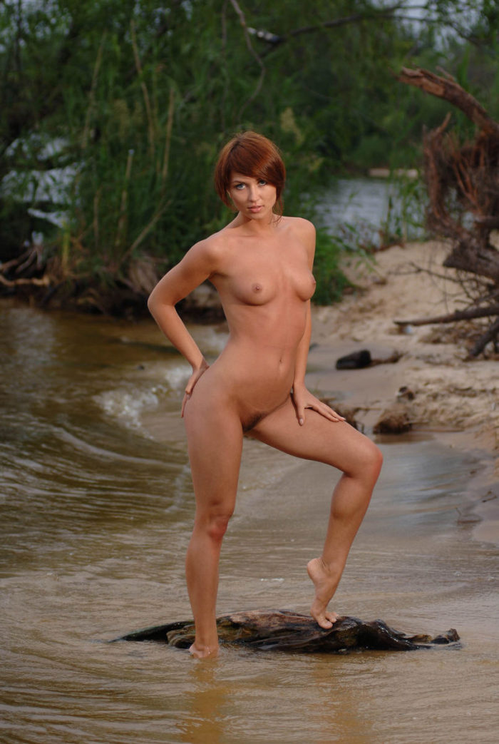 Genevieve Gandi shows off her creamy white body and pink pussy outdoors.