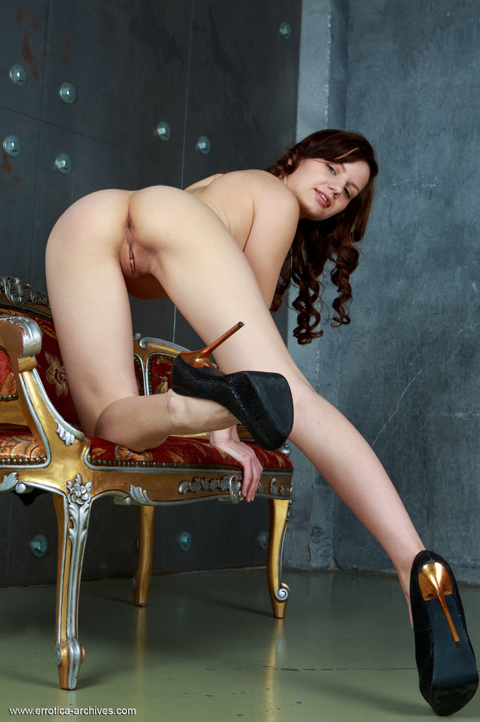 Solana A flaunts her sexy legs and tight ass as she poses on the chair.