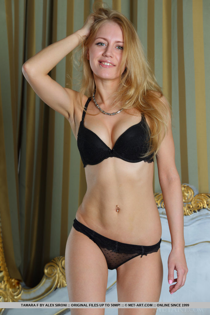 Tamara F strips her black lingerie on the bed as bares her slender body with tight butt.