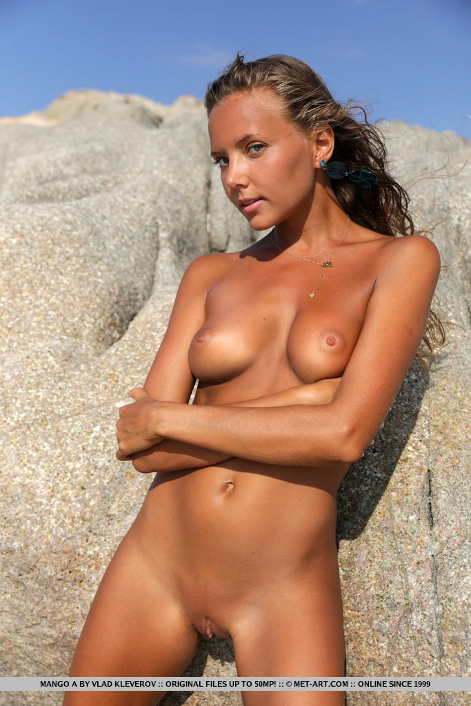 The beautiful Mango A basks under the morning sun, enjoying the beach view, and flaunting her perfectly tanned body