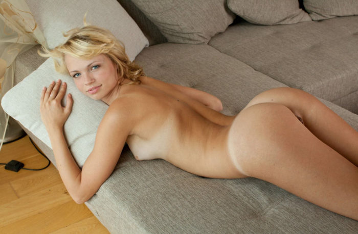 Very beautiful blonde Eve B on gray sofa
