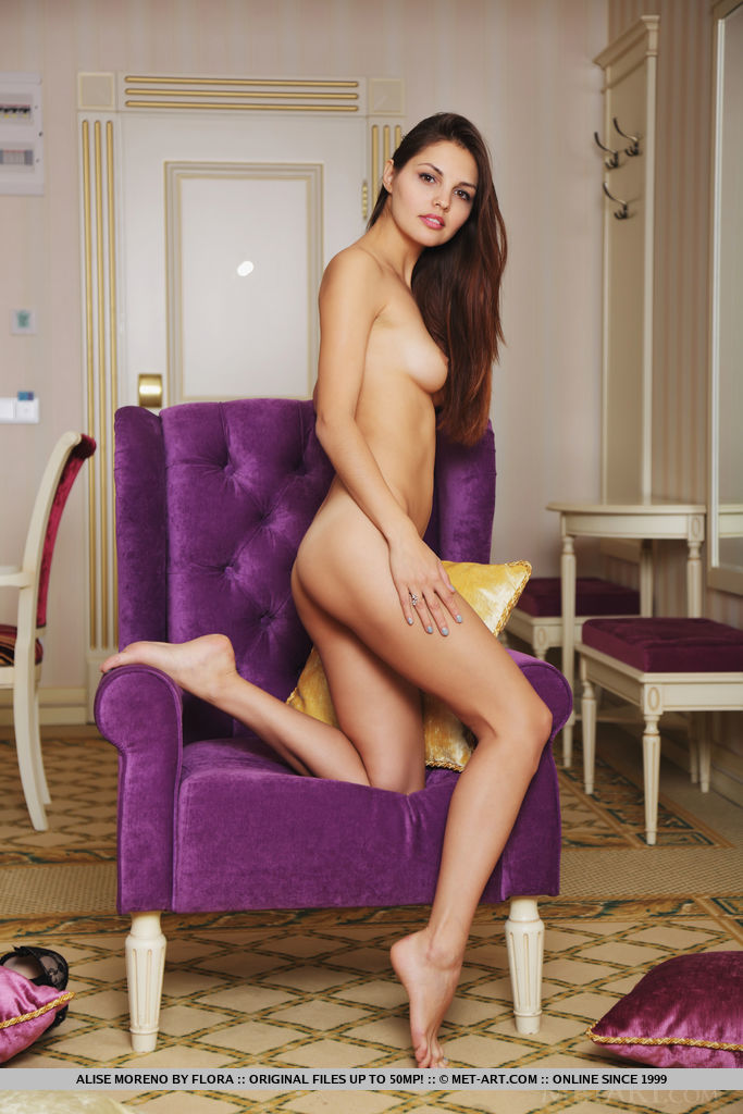 Alise Moreno flaunts her slender body and sweet pussy on the chair.