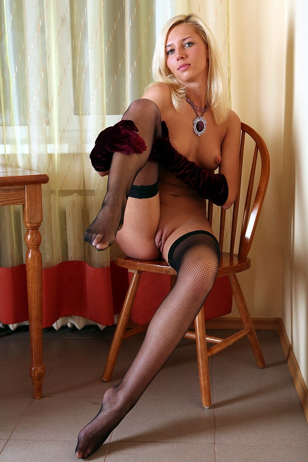Blonde Lena D wears stockings and gloves