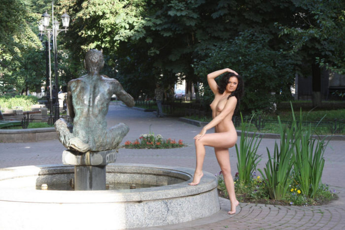 Brunette Vika loves to walk at city park naked
