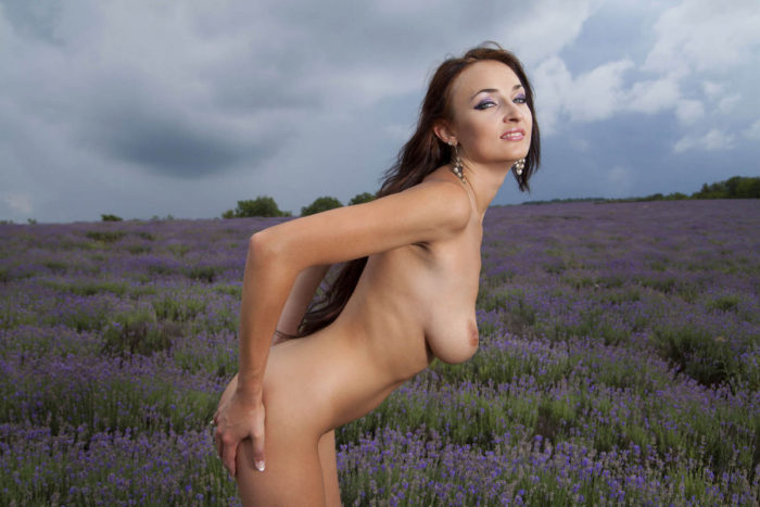 Busty babe Ines A in purple fields