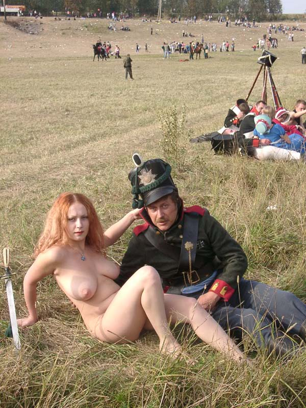 Busty redhead posing naked at historical reconstruction