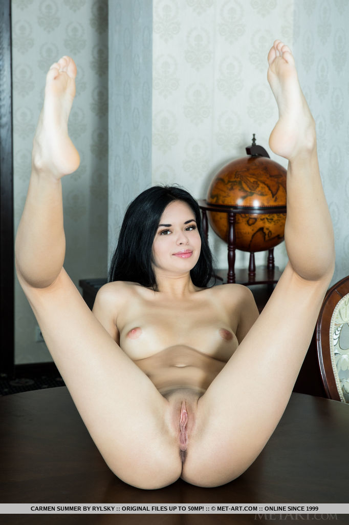 Carmen Summer strips on the chair baring her delectable body and yummy pussy.