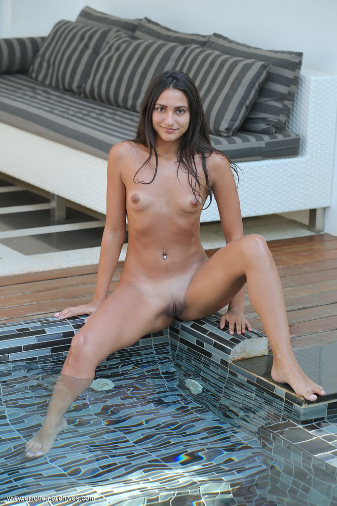 Cira Nerri bares her slender, tanned body as she dips in the pool.