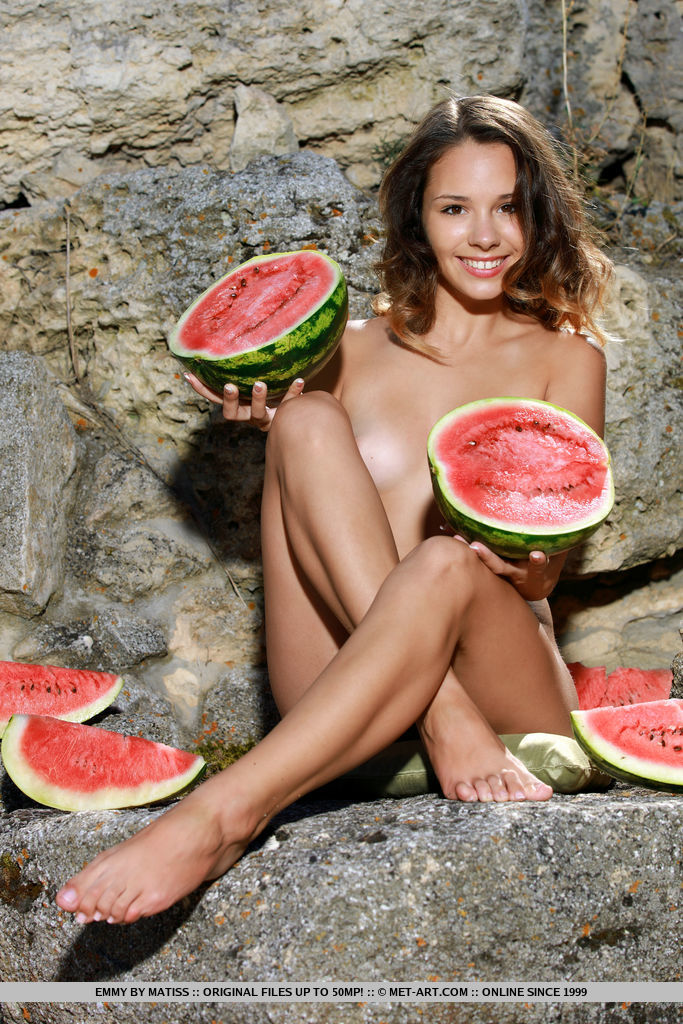 Emmy playfully poses with a watermelon on her sweet body.