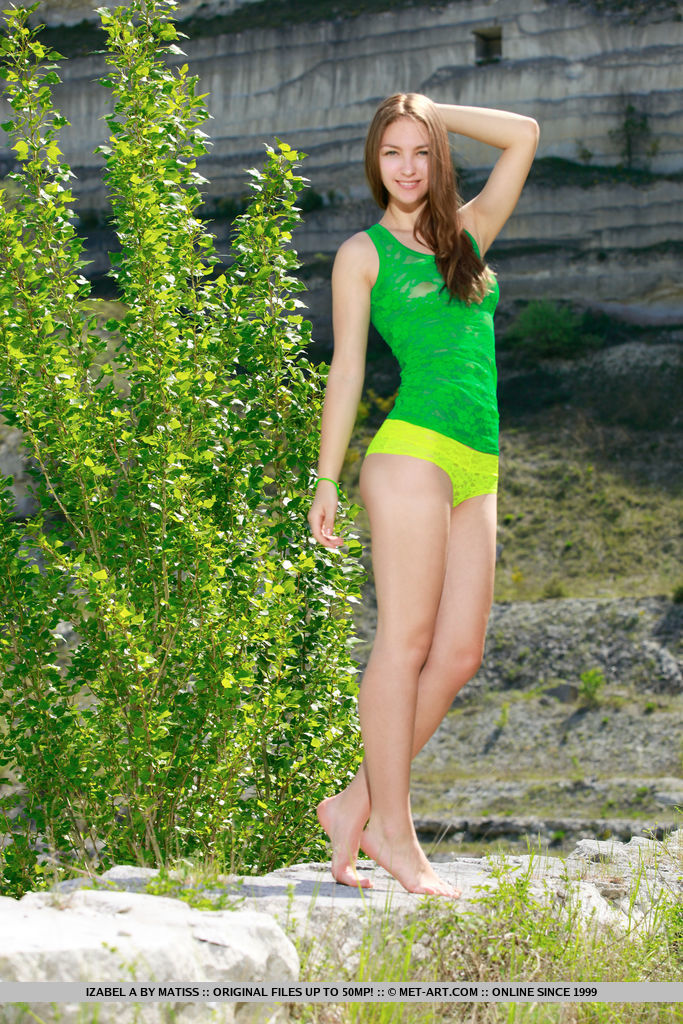 Izabel A delightfully poses outdoors as she flaunts her nubile body.
