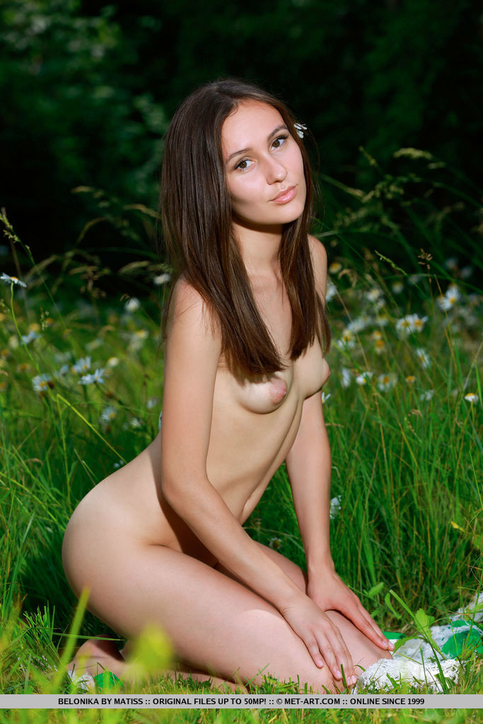 Like a muse or woodland nymph, Belonika's elegant beauty, sweet smile, and nubile body stands out in the verdant surroundings