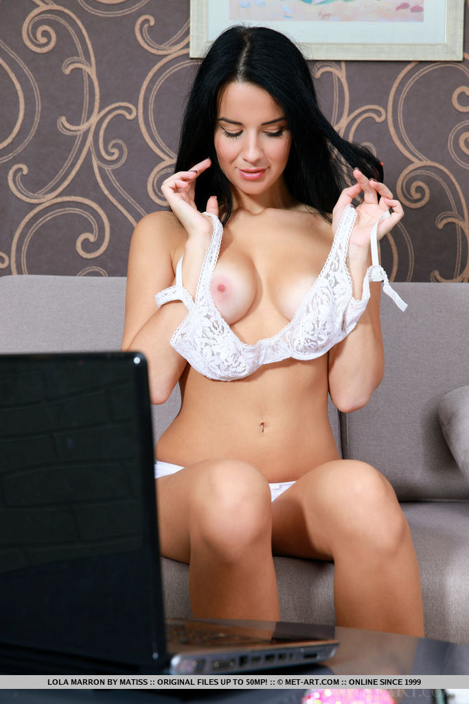 Lola Marron strips on the sofa showing off her delectable body and yummy pussy.
