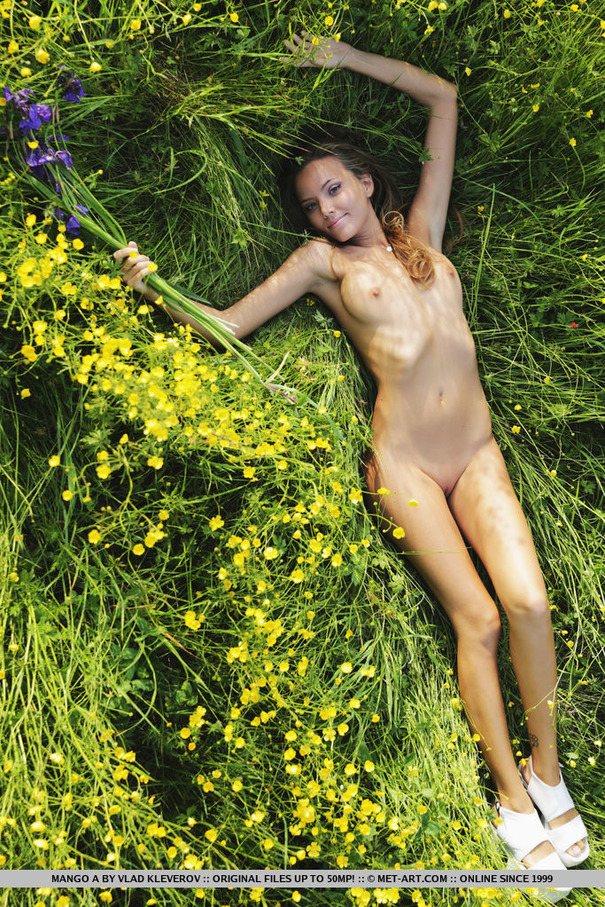 Mango A flaunts her smoking hot body as she poses on the flowery field.