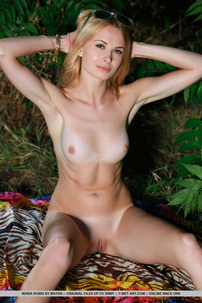 Maria Rubio strips outdoors baring her sweet pussy and tight body.
