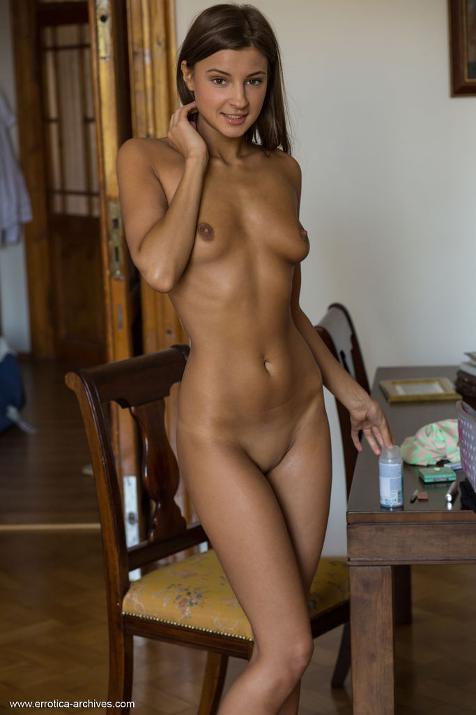 Melena A shows off her smoking hot body as she poses on the dresser.