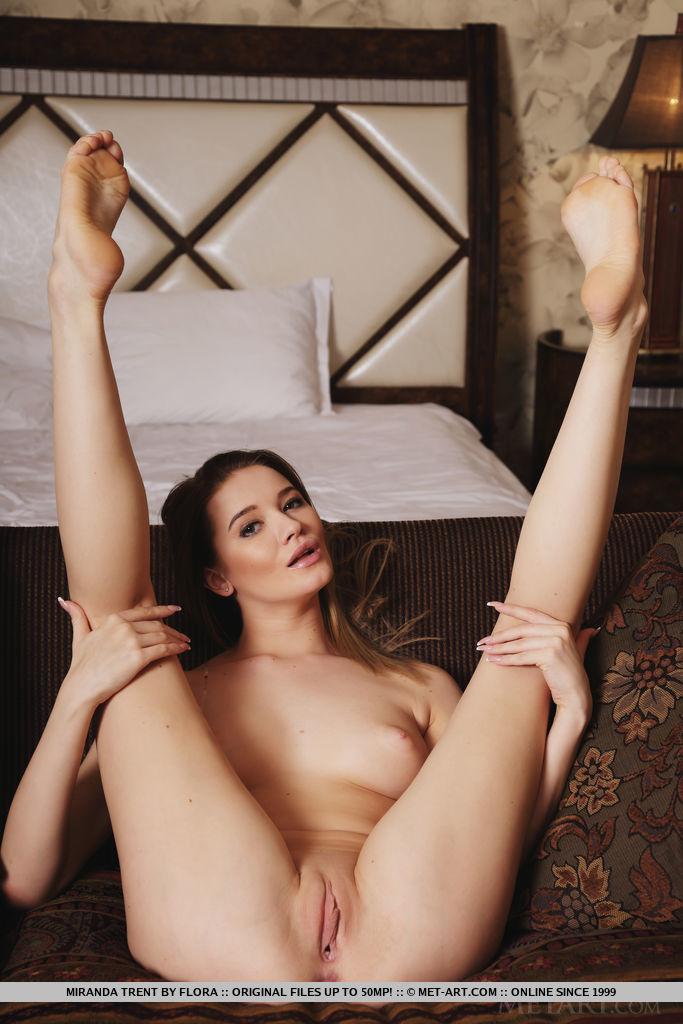 Miranda Trent strips on the sofa as she flaunts her amazing body.
