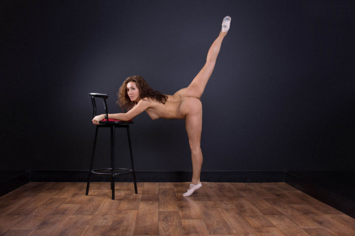 Naked ballerina widely spreads her legs to show hairy pussy