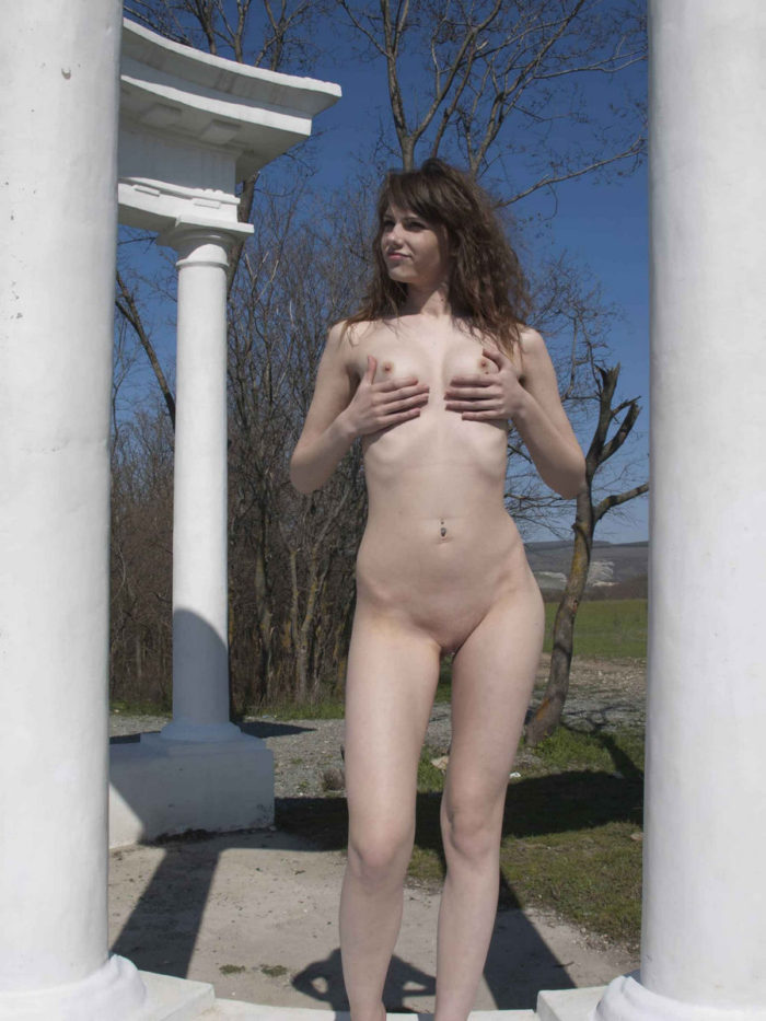 Naked russian babe with strong sexy body outdoors