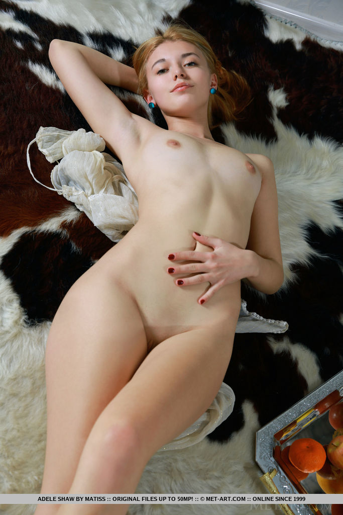 New model Adele Shaw strips on the carpet as she bares her sexy, slender body.