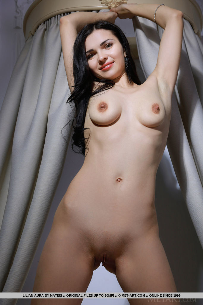 New model Lilian Aura strips on the bed baring her pink nipples and   sweet pussy.