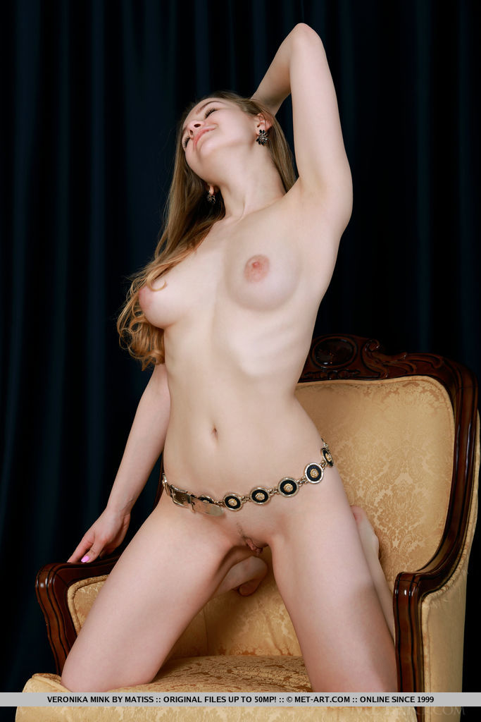 New model Veronika Mink bares her amazing body on the chair.