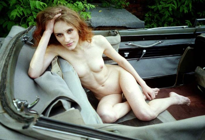 Old photos of beautiful slender redhead in old USSR car