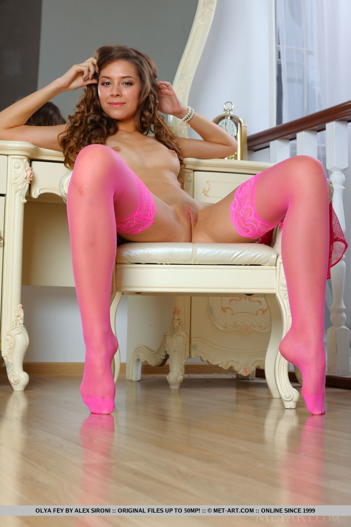 Olya Fey flaunts her sweet pussy as she strips her sexy, pink lingerie.