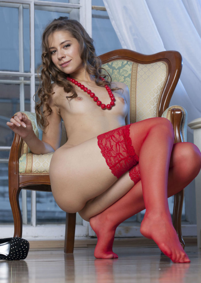 Smiling babe in red stockings