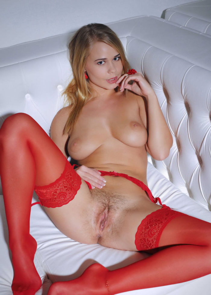 Smiling chic blonde Sarika in sexy red lingerie