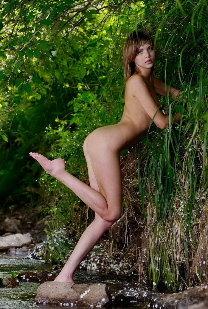 Teen Amelie with sporty body posing at forest river