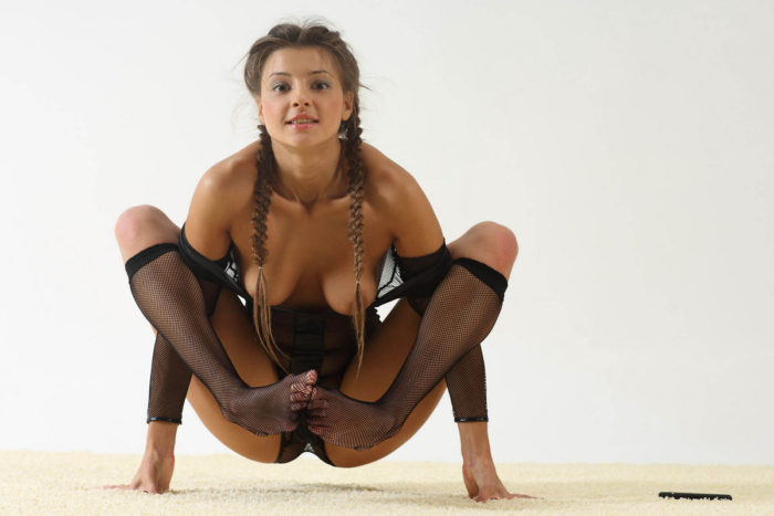 Teen Masha E doing exercises with small dildo in her pussy